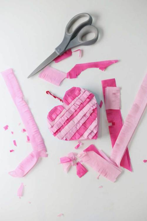 Easy to make mini heart pinata that are pink and made with Crete paper.