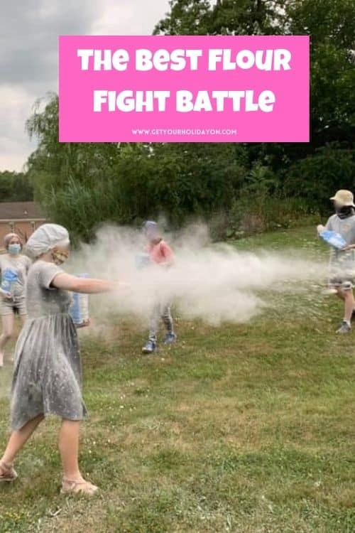 Teens throwing flour on each other for a flour fight battle.