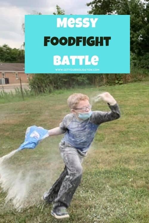 foodfight battle with a teen boy throwing flour outside.