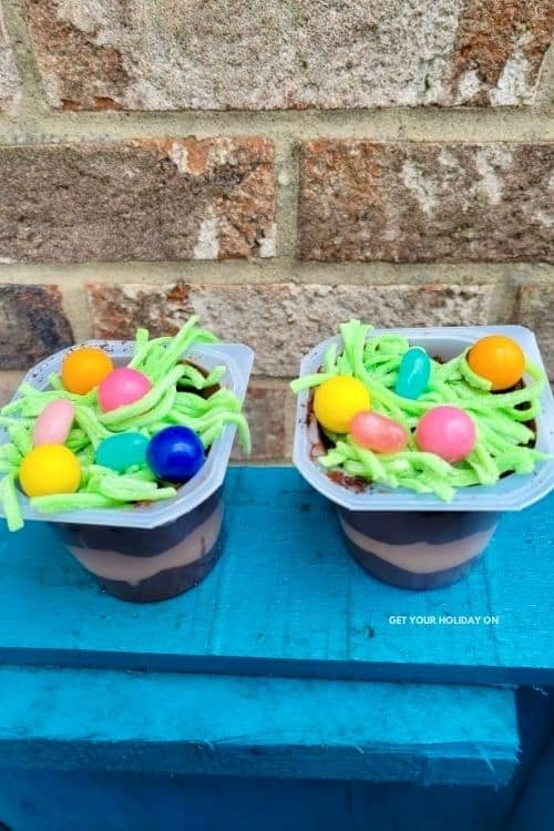 pudding cups with edible treats inside of them for adults.