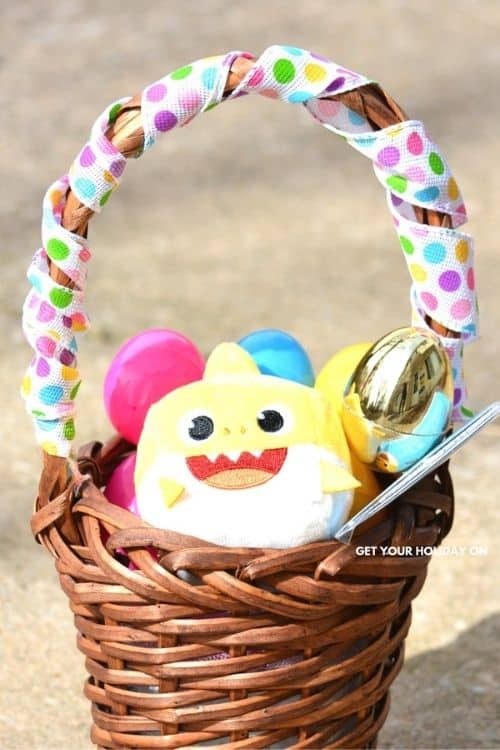 baby easter basket with shark plush and eggs