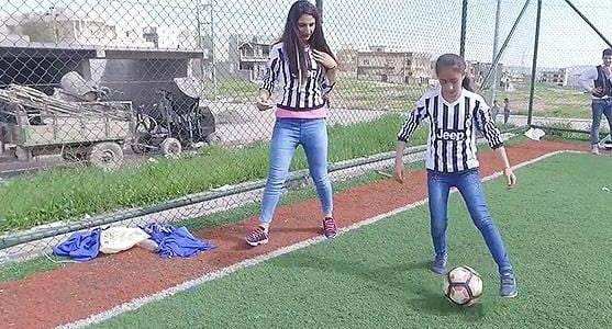 Mosul girls displaced by Islamic State play football in Kurdish town