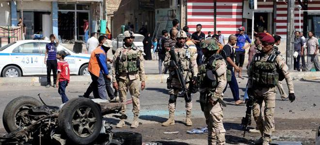 Two Iraqi policemen killed inside a town west of Baghdad