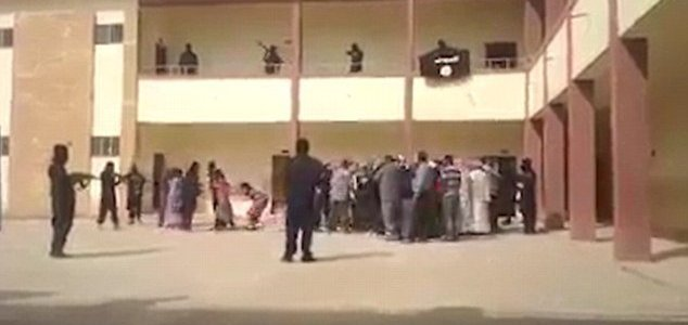 Footage released by Yazidi group shows terrified families scream as ISIS gunmen surround them