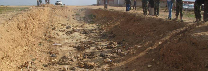 Special team exhuming Yezidi mass graves come under fire