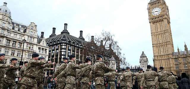 Police launch manhunt after soldier in uniform is attacked on the streets of London