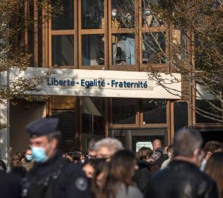 GFATF - LLL - Terrorist suspect stalked French school before beheading of a history teacher