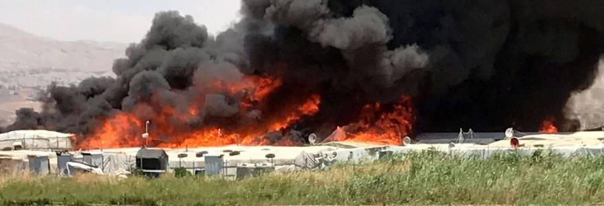 At least seven people dead after fire erupts in Islamic State camp in north Syria