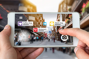 Augmented reality marketing concept. Hand holding smart phone us