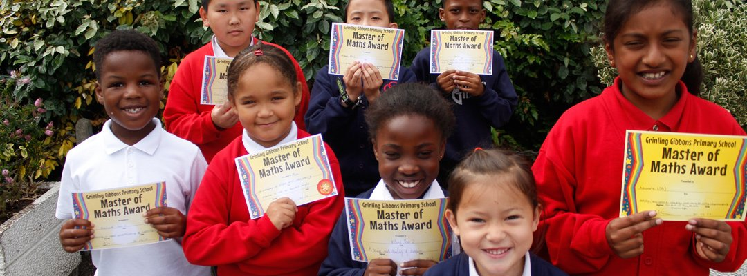 Group of children holding up their Maths certificates
