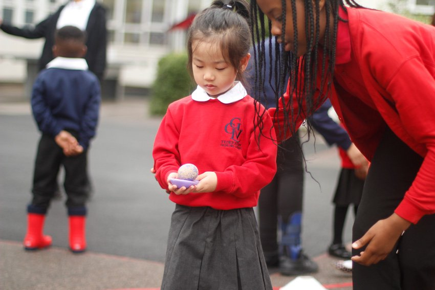 Year 6 pupils helping in the playground