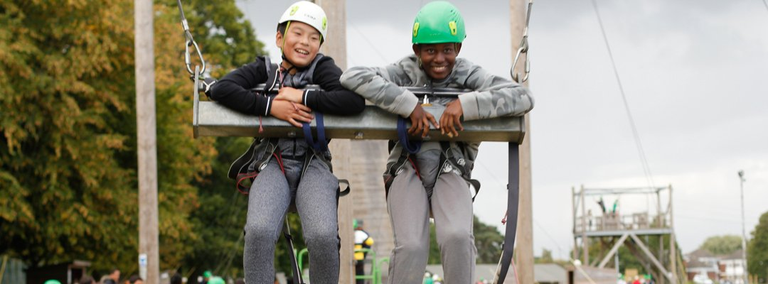 Two children on a zip wire at Kingswood