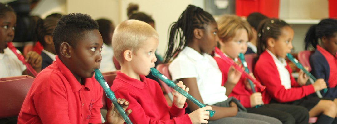 Children learning the recorder