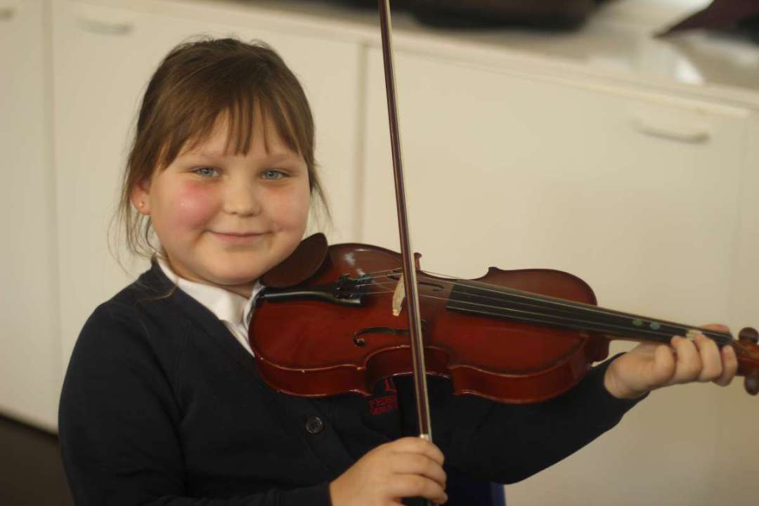 Student enjoying her violin lesson