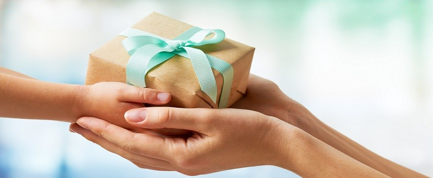 two-people-exchanging-gifts