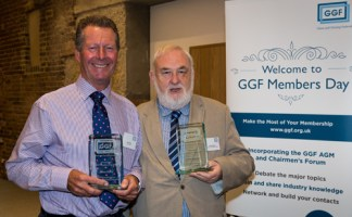 Brian Baker (left) and Brian Waldron receive their awards