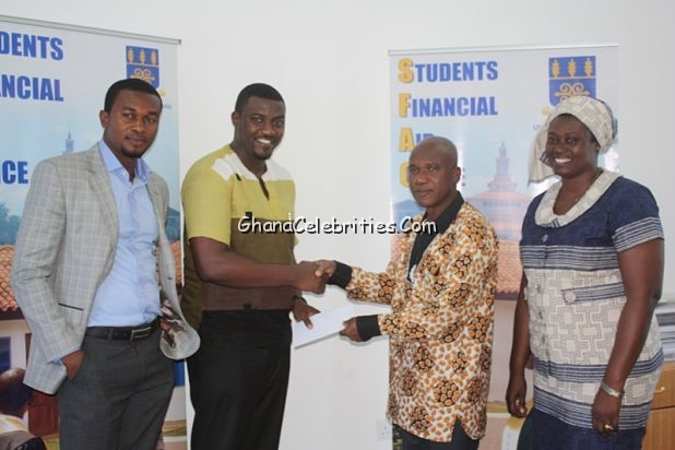 John Dumelo presenting the cheque
