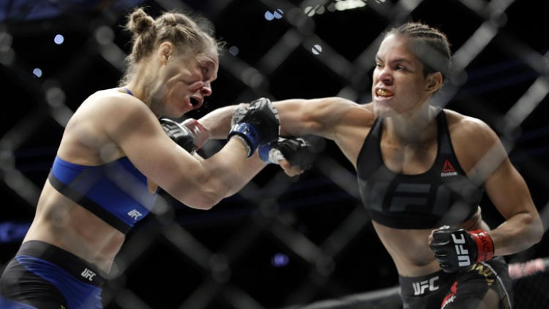 Rousey eats a punch from Amanda Nunes in her devastating loss