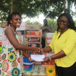 Ms. Emma Coleman (right), Head teacher of North Hills International School Presenting the Items to the Orphanage
