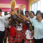 General Manager of the School, Madam Bernice Ayim, (extreme left) presenting trophy to the winning house