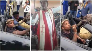 Photo of Pastor Captured On Camera Kissing And Playing With Big Snake In Traffic – Video Below