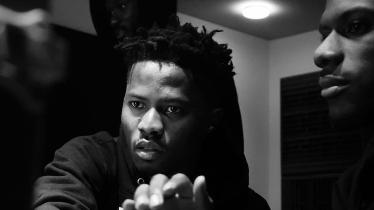 Kwesi Arthur indulges fans to report a verified fake facebook account in his name