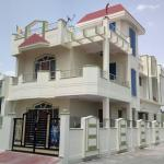 Duplex House 4bhk Corner Plot With Ss Railing Wooden Door Windows Sloped Roof Balcony Decorative Porch Ceiling Ms Gate Grill And Compound Wall Gharexpert