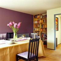 Wine colored paint on the wall, Simple wooden bookcase ...