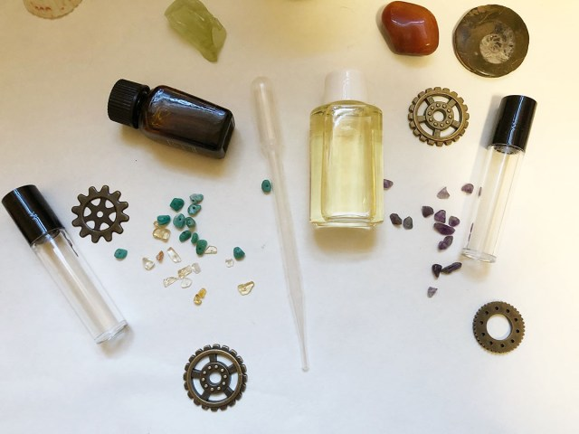 roller top bottle, eyedroppers, crystal chips, and essential oils to make a protection oil roller