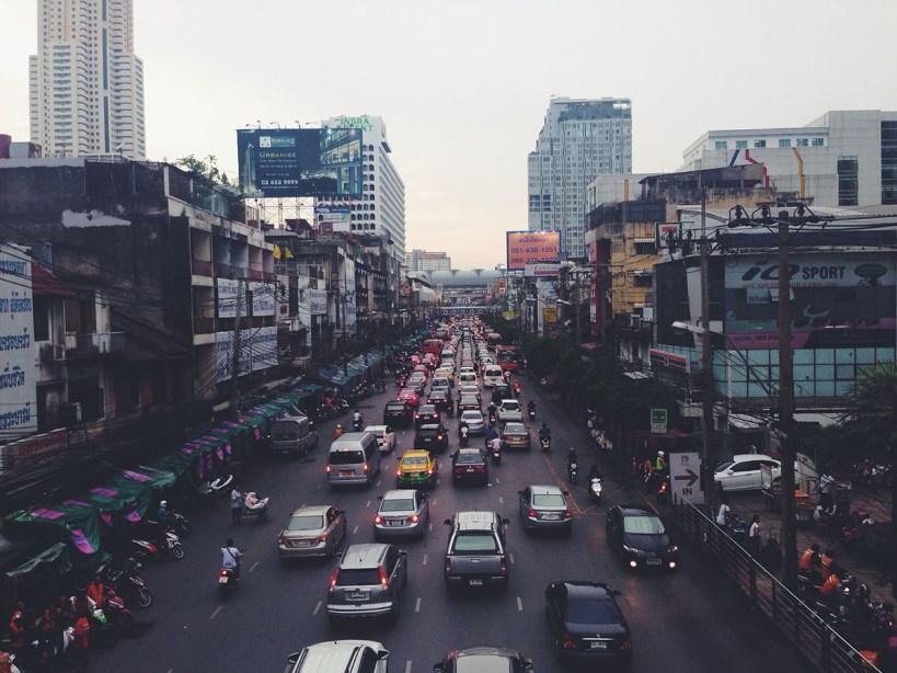 a scene of heavy traffic in a big city