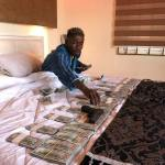 Shatta Wale Lights Up The Internet AGAIN; Flaunts Thousands Of Dollars On His Bed In This Viral Video