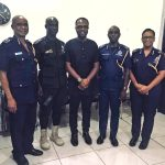 Photos: KOD Rewards Police Man Who Carried School Children And Women On His Back During Floods In Accra