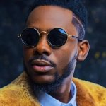 Adekunle Gold 'Fight' With Olamide On Twitter, Unfollow Each Other