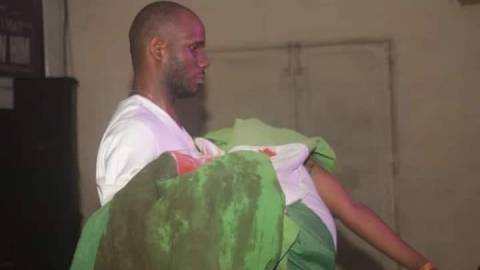 Photo: See The Sad Moment Female Protestor Died And Was Wrapped In A Bloody Nigerian Flag