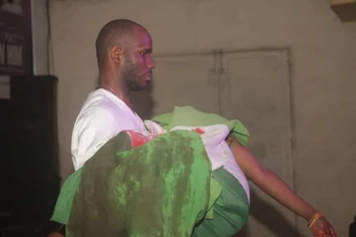Photo: See The Sad Moment Female Protestor Died And Was Wrapped In A Bloody Nigerian Flag 2