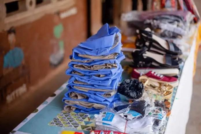 Gloria Lardi, a teacher provides bags, uniforms, and shoes for the students. (PHOTOS). 9