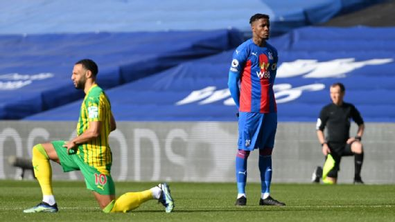 Moment Crystal Palace's Wilfried Zaha refuses to take a knee before the start of a Premier League game