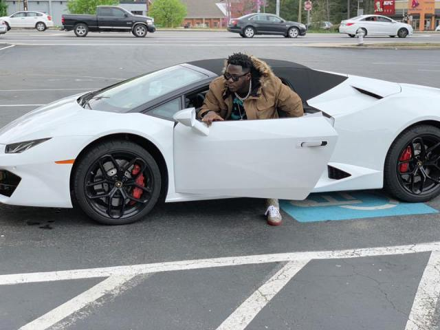 Medikal in a Lamborghini