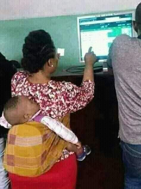 Nursing Mother Spotted Staking Bet At Betting Center 2