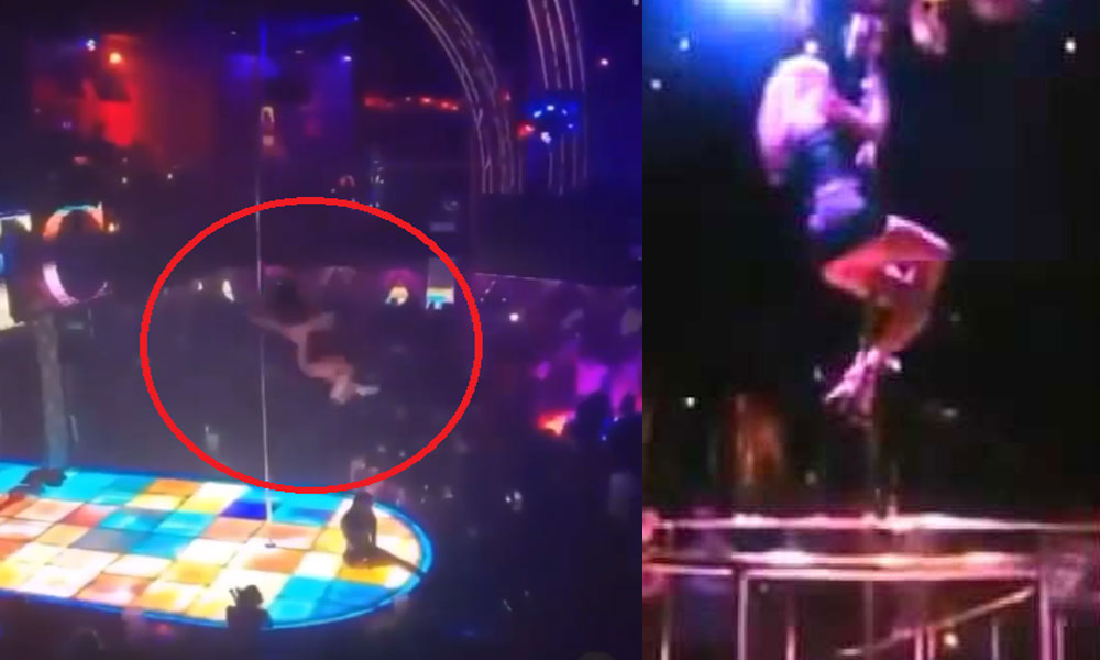Image result for Moment stripper falls from high pole while dancing  youtube video)