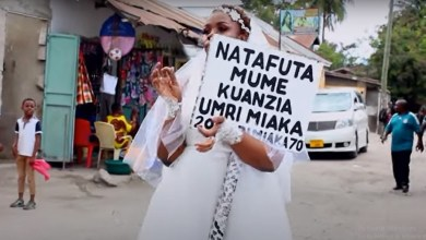 (+ VIDEO) I have money, I'm still a virgin lady cries out as she hit the street on wedding gown to look for a husband