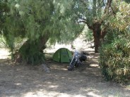 The last time I was here, this entire vacant lot was filled with tents. This time, it's just my tent and the Vector enjoying the shade of a huge cyprus tree.