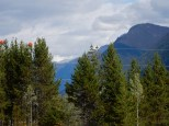 Some late summer snow clings to the mountains east of Blue River, BC during a gas/snack stop.