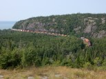 A Canadian Pacific intermodal train crosses a river at the west boundary to Nays Provincial Park in Ontario.