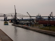 The Soo Locks tour boat exits the Soo Locks. The Cason J Callaway's lock is filled and the gates are about to open.