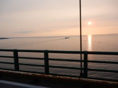 The Arthur M Anderson steams toward the sunset east of the Mackinac Bridge. This photo was foolishly snapped from a moving motorcycle, in traffic, holding the camera in my throttle hand, on the Mackinaw Bridge, with just a railing separating me from a several hundred feet drop into the water. I do not condone this activity! I could have easily ended up a nominee for this year's Darwin Award.