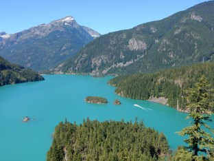A fishing(?) boat cruises on Diablo Lake.