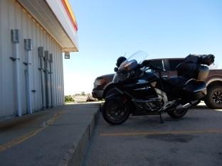 The Nightowl enjoys a rare shady spot during a gas stop near Overton, Nebraska.