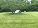 Our cozy hideaway for the weekend, nestled next to a tree for a bit of morning shade.