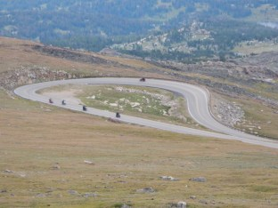 A group of bikes negotiates one of the many switchbacks up Beartooth Pass.